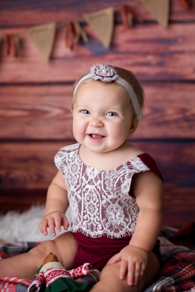 9 month baby girl with Christmas themed decorations