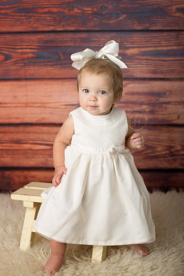 baby girl first birthday session in white dress
