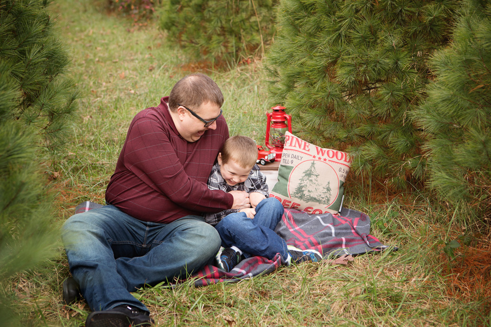 Tickle time at this year's Christmas tree mini session with Jessica LS Photography