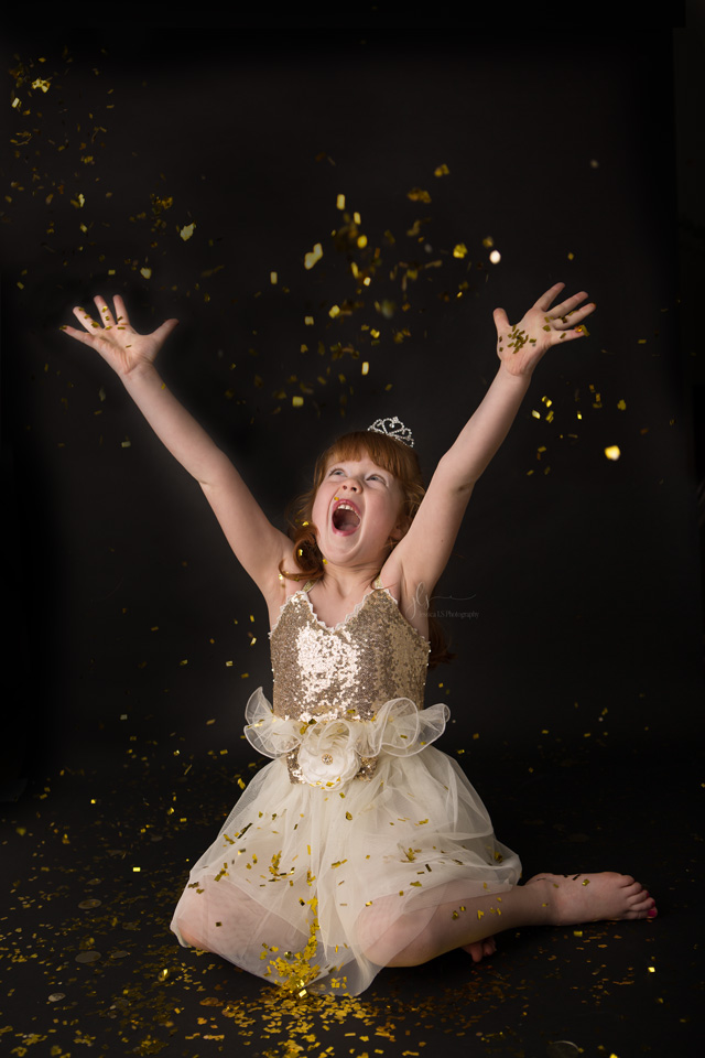 girl having fun with gold glitter