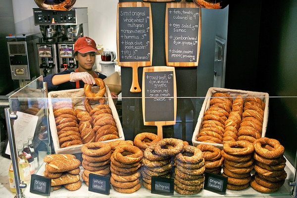 The simit, a large bagel beaded with sesame seeds/Via The New York Times
