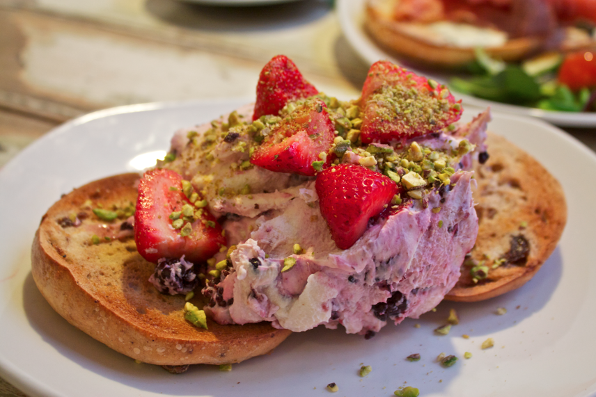 Fruit & Nut Bagel w/ Mixed Berry Mascarpone, Strawberries & Pistachio Dust