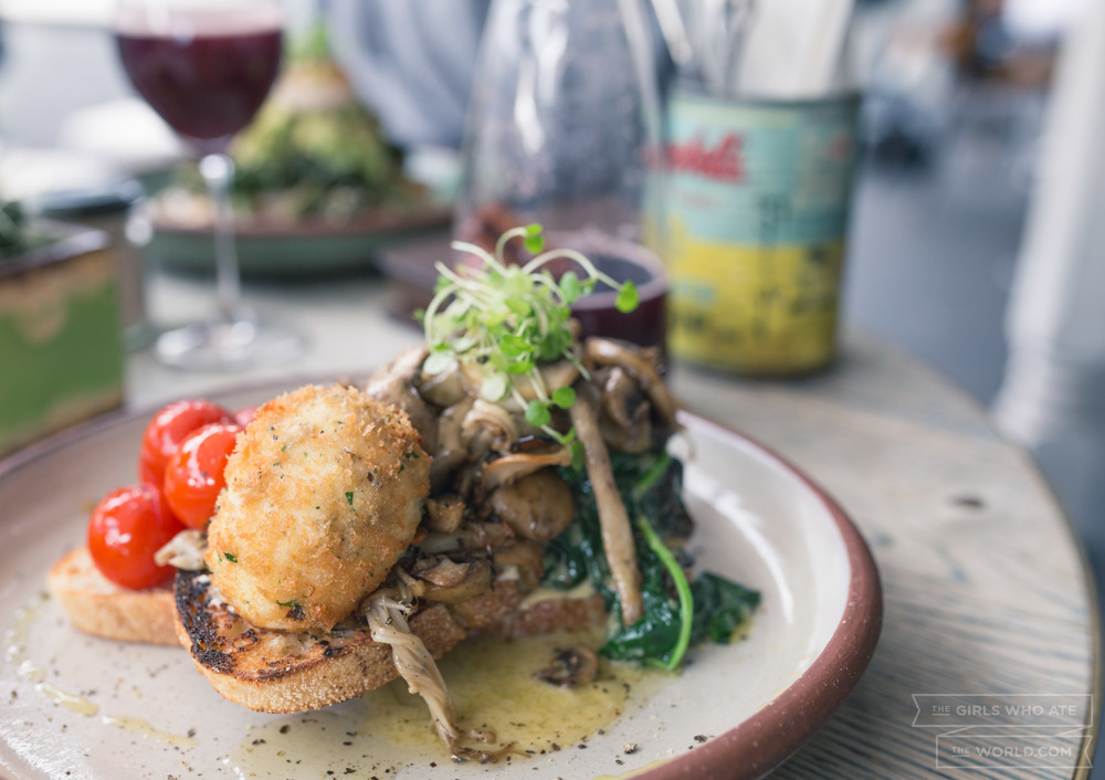 Magic Mushrooms (23) - Wild mushrooms on sourdough served with truffled goat's cream, spinach, roasted truss tomatoes, smoked almonds and a crumbed egg