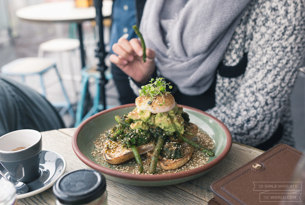 Green Eyed Monster (20) - Sautéed green beans, broccolini & kale with spicy chermoula, avocado, lime, labnah and a dukkah poached egg served on sourdough