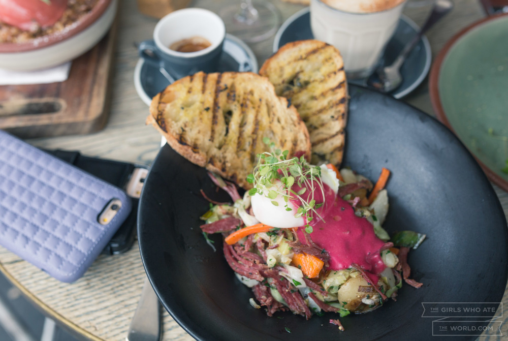 Holy Grail (20) - Corned beef brisket and potato hash with shredded carrot, cabbage, leek, a 63° poached egg and beetroot hollandaise served with sourdough