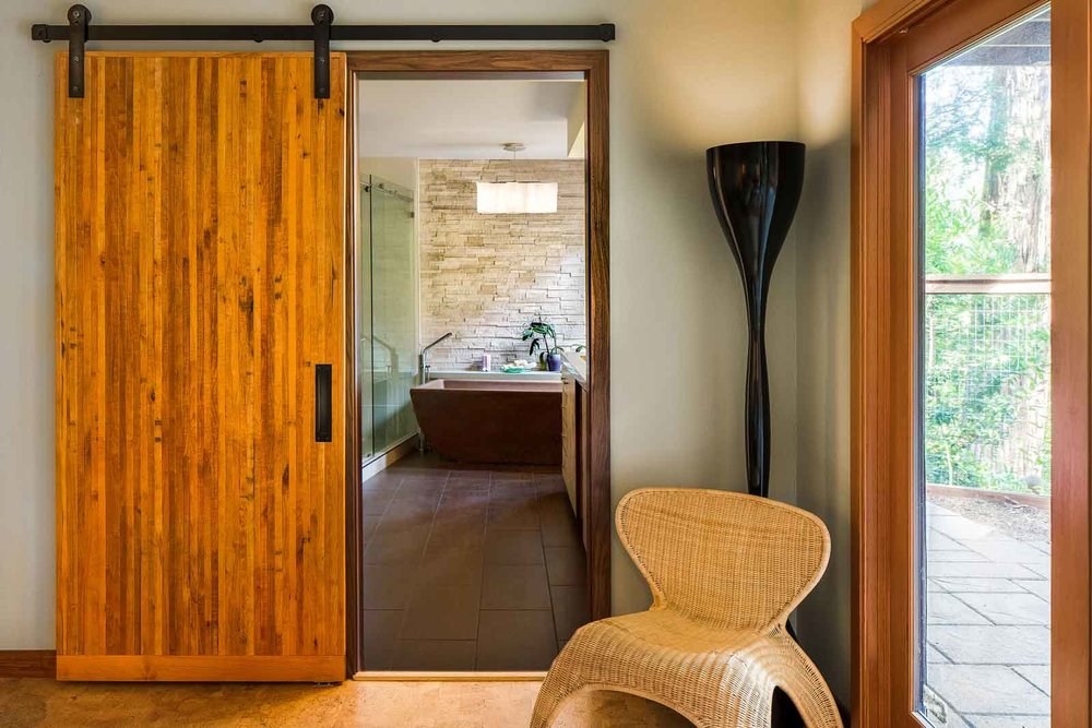 Barn door entrance to remodeled bathroom suite
