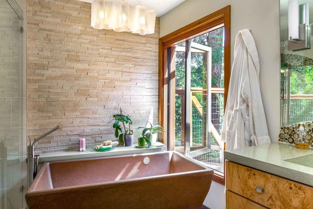 Kobe walnut wood folding window from concrete freestanding tub