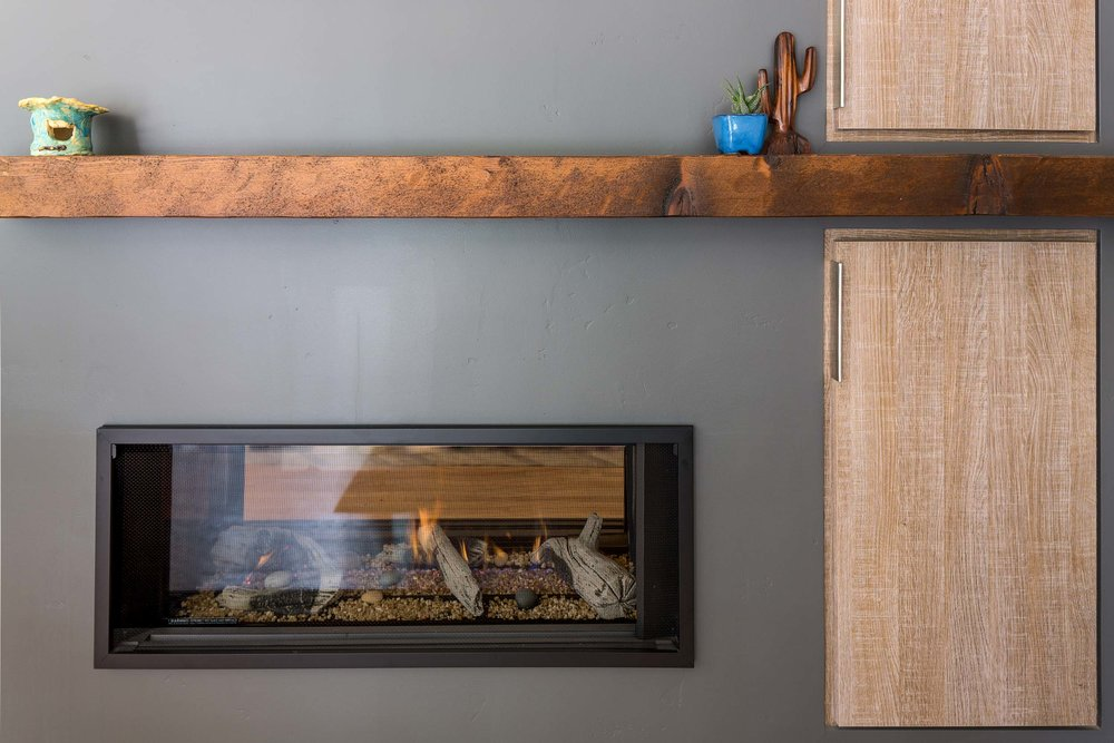 Two Sided Modern Fireplace with Rustic Mantel