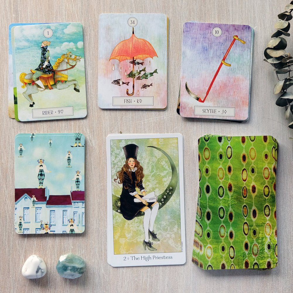 These decks remind me of the distinctively whimsical, romantic, lighthearted quality of Korean art I would stumble upon in little boutiques and in craft markets in Seoul.
