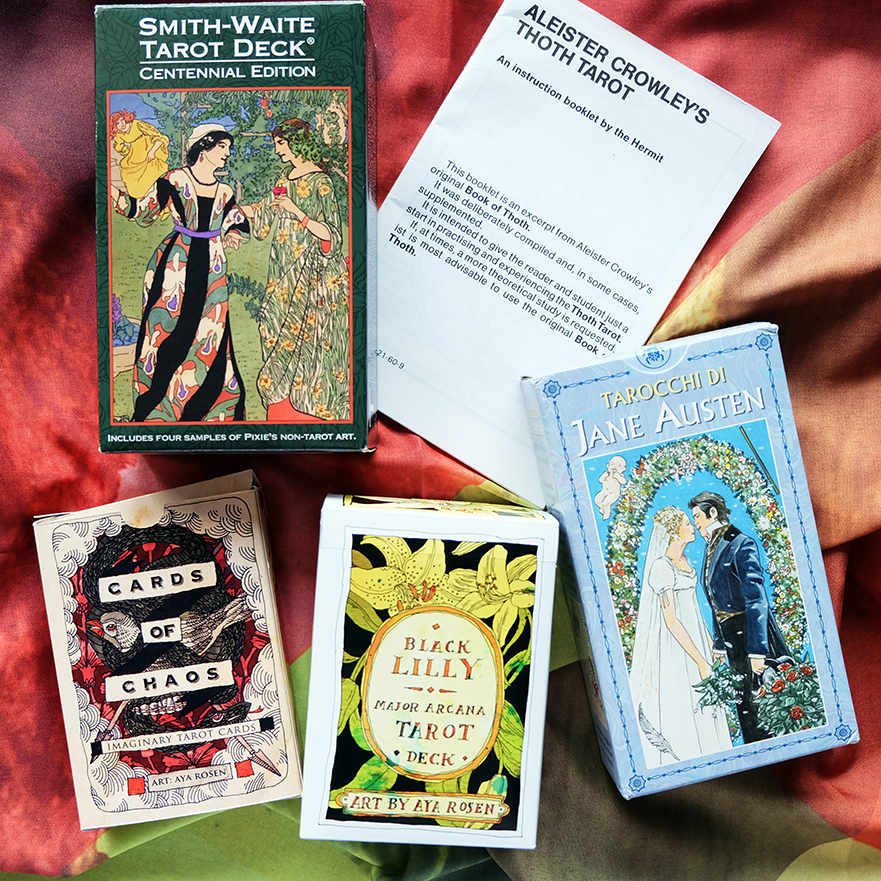 Decks used:  Centennial Smith-Waite  (Pamela Colman Smith, US Games),  Cards of Chaos  and  Black Lilly Tarot  (Aya Rosen, Gamecrafter),  Tarot of Jane Austen  (Diane Wilkes, Lo Scarabeo)