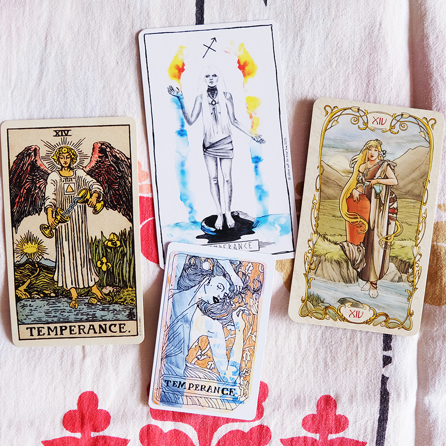 Decks used:  Centennial Smith-Waite  (Pamela Colman Smith, US Games),  Lumina Tarot  (Lauren Aletta, Inner Hue),  Tarot Mucha  (Lo Scarabeo),  Metro Tarot Cards  (Aya Rosen, Gamecrafter)