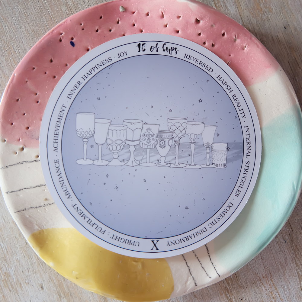 This deck will look gorgeous on an altar! And I love how it works with my little plate from  Hey Kessy Pottery .