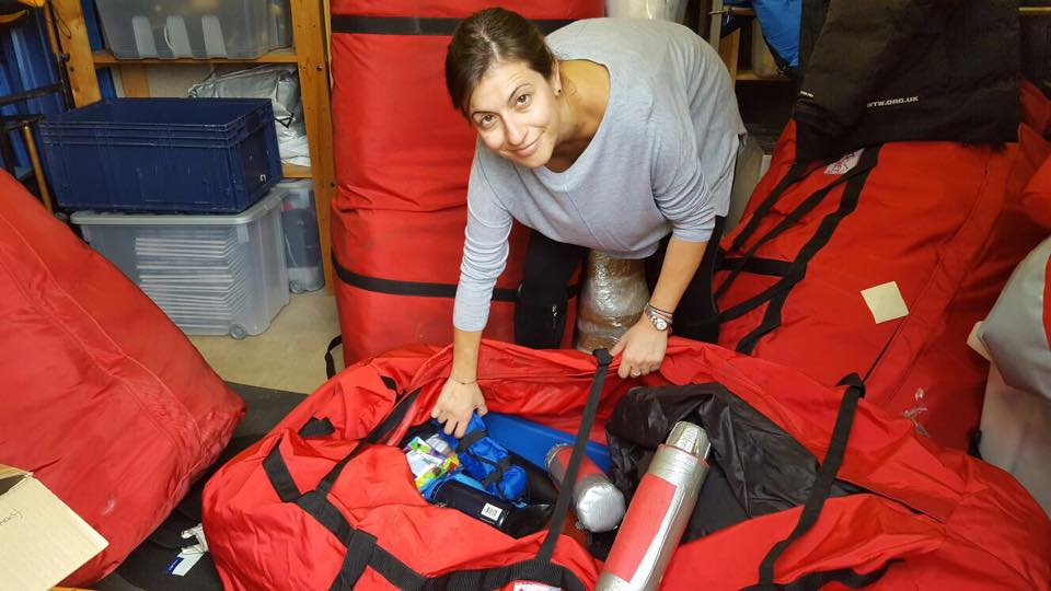 Steph from Cyprus packing expedition equipment in the UK, ready for shipping to Iceland