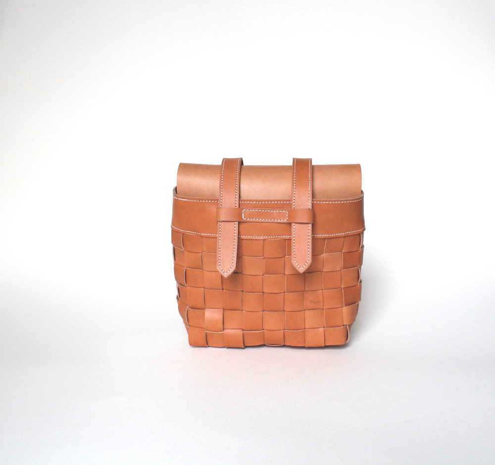 Product development . Fannypack made from US sourced vegetable tanned leather, sun tanned and waxed (house-blend) biodegradable thread and lining.