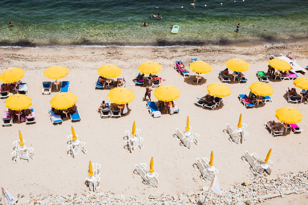 sicily beach yellow umbrellas