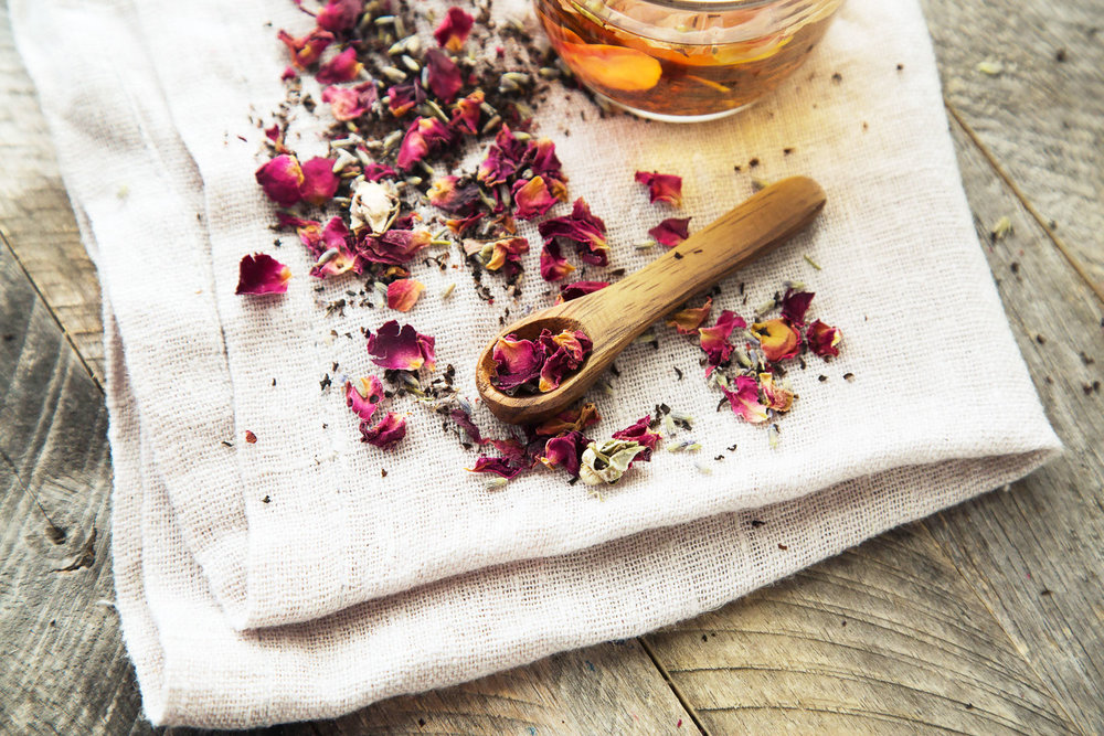 rose petal tea scattered on wood
