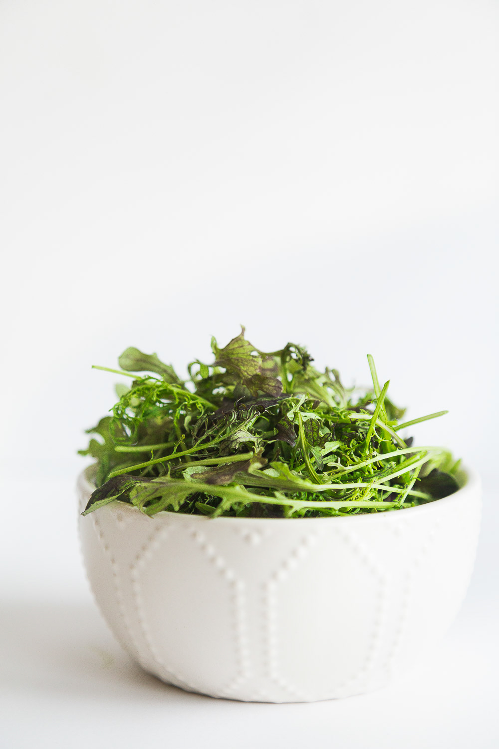 baby mustard greens in a bowl