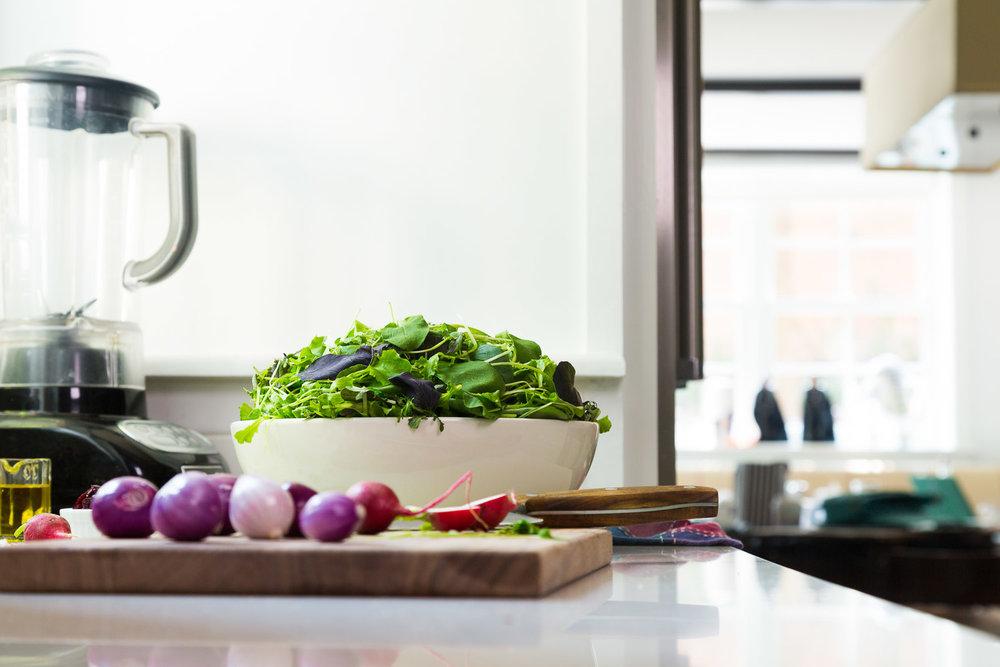 baby salad greens in white kitchen
