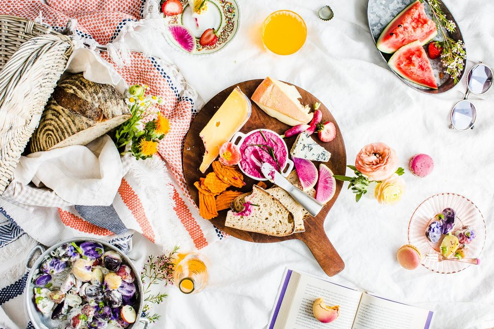 summer picnic with pink and purple food