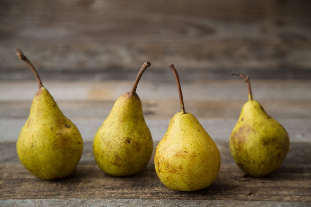 yellow pears on rustic barnwood