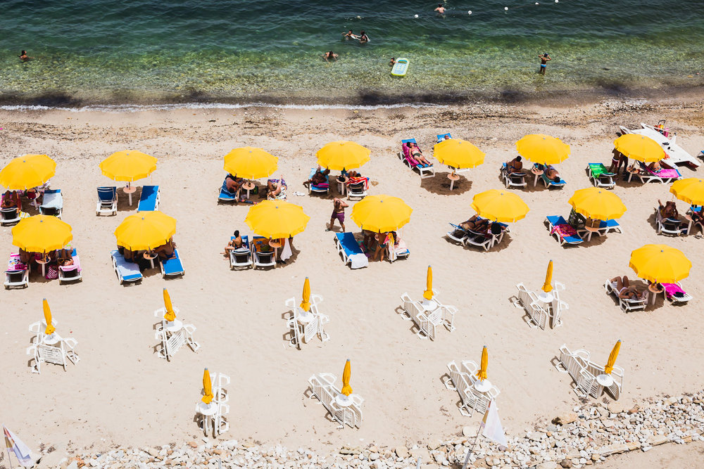 yellow umbrellas on a sicilian beach