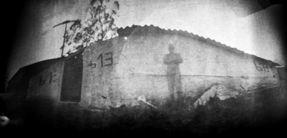 Murilo in front of his house.jpg