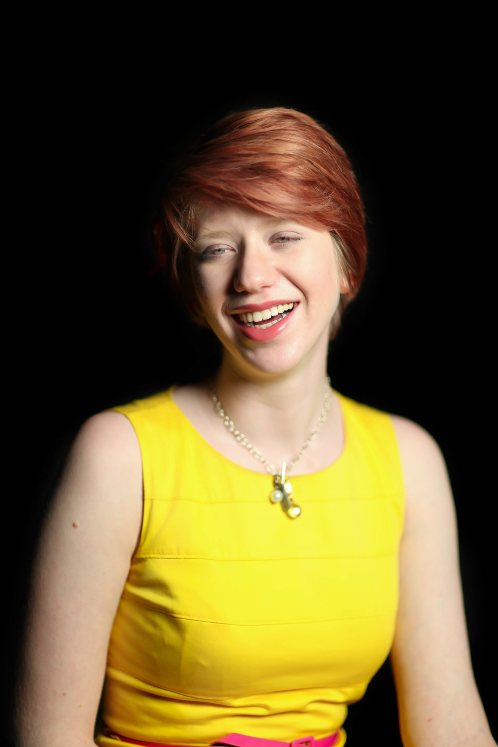 """Cassandra's parents are from Puerto Rico and moved to the mainland United States when her father was recruited to work at the Air Force base in Dayton, Ohio. She is a Computer Science & Engineering major at Ohio State. Cassandra was born with the condition Albinism, which she attributes to influencing her experience in the American and Puerto Rican communities.    """"'It's hard having an obvious disability because people do make assumptions and people do get kind of weird about it. [They say things like] """"OMG you can't see as normally as everyone else."""" But that is just part of it. It is weird because I speak Spanish, I am fluent in Spanish, but even when I go to Puerto Rico, people look at me really weird and I know they are talking about me because I can understand them. So, sometimes I just slip in a couple words and they are like """"Oh no, she knows what I am saying.""""  People just assume that I am white, because I look white, because of the pigmentation of my skin, so it's really weird because I haven't really faced any racial or ethnic discrimination. So while my brother was bullied in middle school, people were telling him to go back to his country, which is ironic just because we're already there. We've (Puerto Ricans) been US citizens for years and years and years. That really made him feel isolated, which is why I think he looked for that community, but I never had that [experience] because other white people also assumed I was white.  Then again, I have never been able to connect with a lot of people based on my heritage. I have my family, of course, and a lot of people with my same condition, we talk about that. Other people from India, different countries, we all get it-- we don't look like the people of our skin color and then they (people) kind of make assumptions. It's really sad because I would like to connect with people of my heritage, but it's what is ingrained in people's minds, that you have to look a certain way to be Hispanic.""""'"""