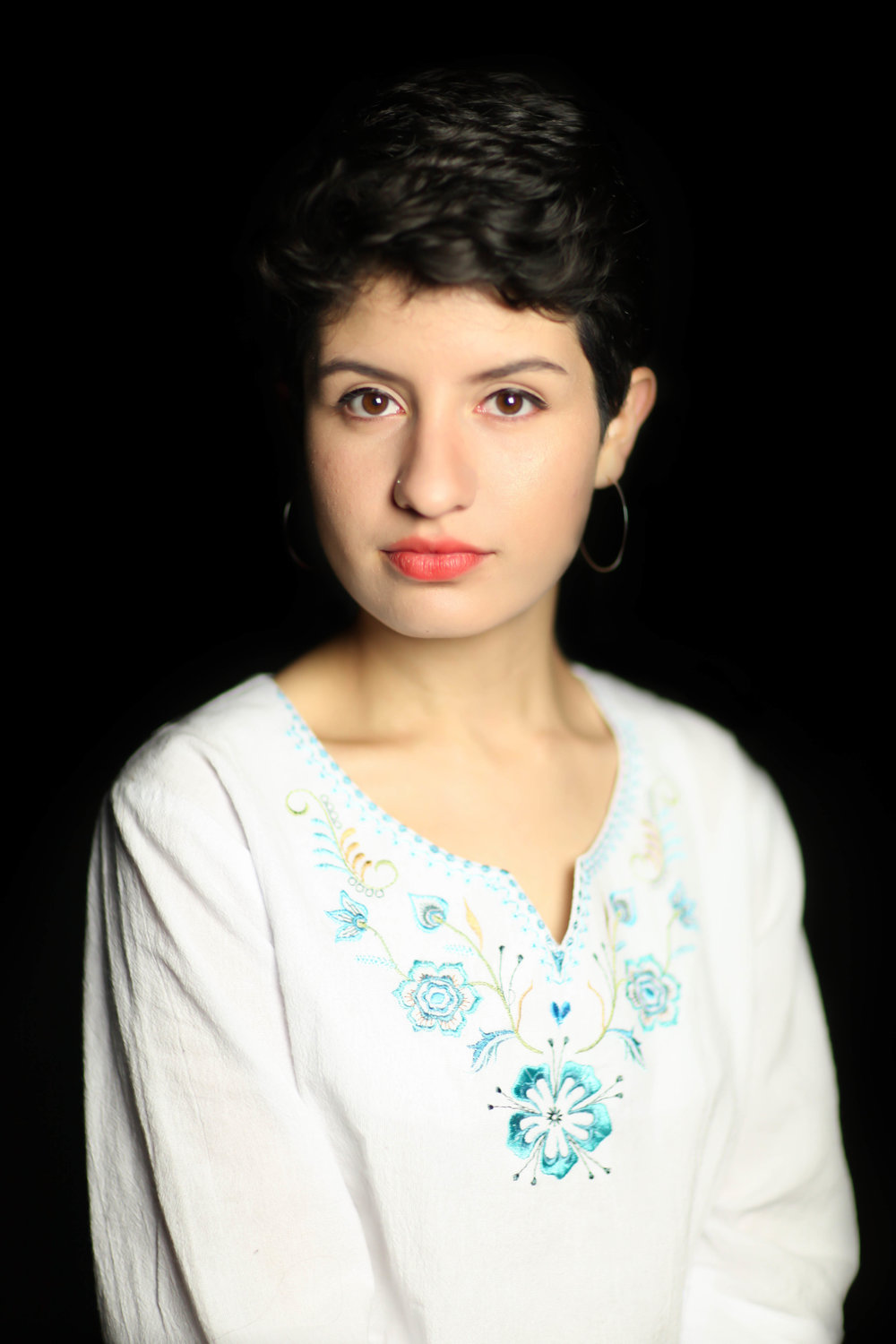 """Maria was born in Ecuador and moved to the United States with her parents at the age of 5. She an advocate in the community for social change and justice in the Latinx community and identifies as being queer.     """"Being a queer woman of color has opened me up to a beautiful, intellectual community of people who face similar struggles as me.    Being Latino [in America], you are always conflicted between two different things--because you are in America, you are not fully in your Latino community, and you are not fully American or white. You are always in between two [communities], you are navigating two different things. And the same in being bisexual, you are navigating between two different preferences. Like do I want to date a man? Do I want to date a woman? So, for me, anyway, those two things are constantly in conflict.    I am always in this in-between with everything I am. That is just who I am. In terms of geography, I'm from New York so I identify heavily with New York, but I am in Ohio right now and I have to be in the community here. There are a lot of places in my identity where I am in the in-between, so it has been a lot to traverse—sort of figuring out where I am, how I am going to navigate this constant journey between different places, different identities, different ideas. But, in the end, it's beautiful. And I just feel very fluid, which is great because as much as I love having an identity, I just love to fluidly be in between...and I'm this and I'm that. But I don't always have to identify."""""""