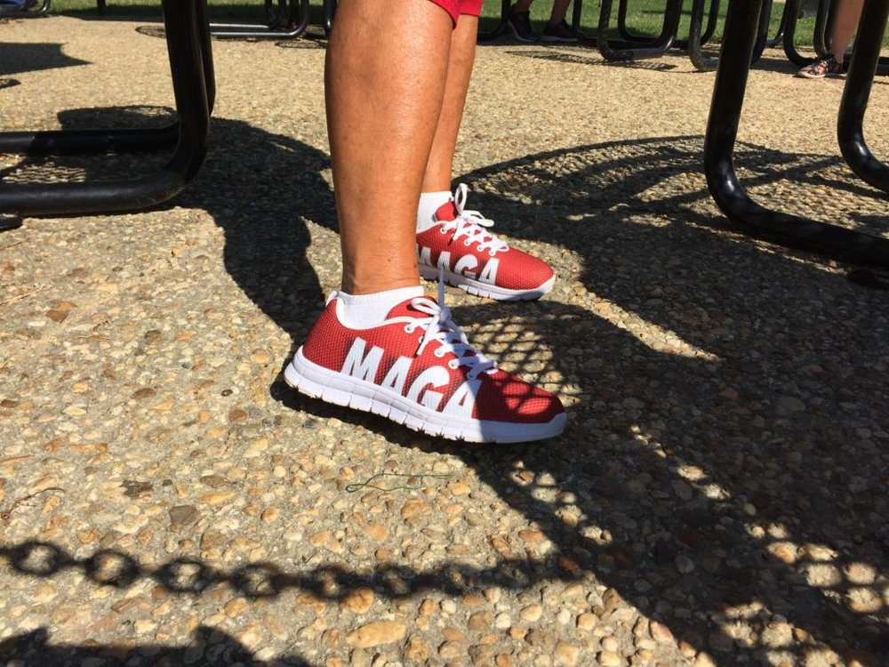 "MaryAnn Pistilli shows off her ""MAGA"" sneakers on the National Mall in Washington at the Mother of All Rallies, Saturday, Sept. 16, 2017. (Lindsey Leake)"