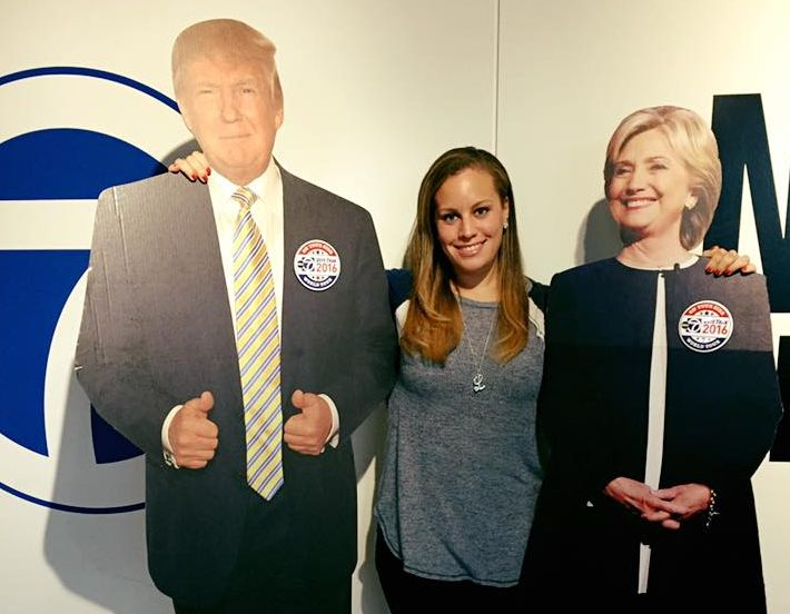 Lindsey poses with cardboard cutouts of then-Republican presidential candidate Donald Trump and former Secretary of State Hillary Clinton at WJLA-TV in Arlington, Va., October 2016.