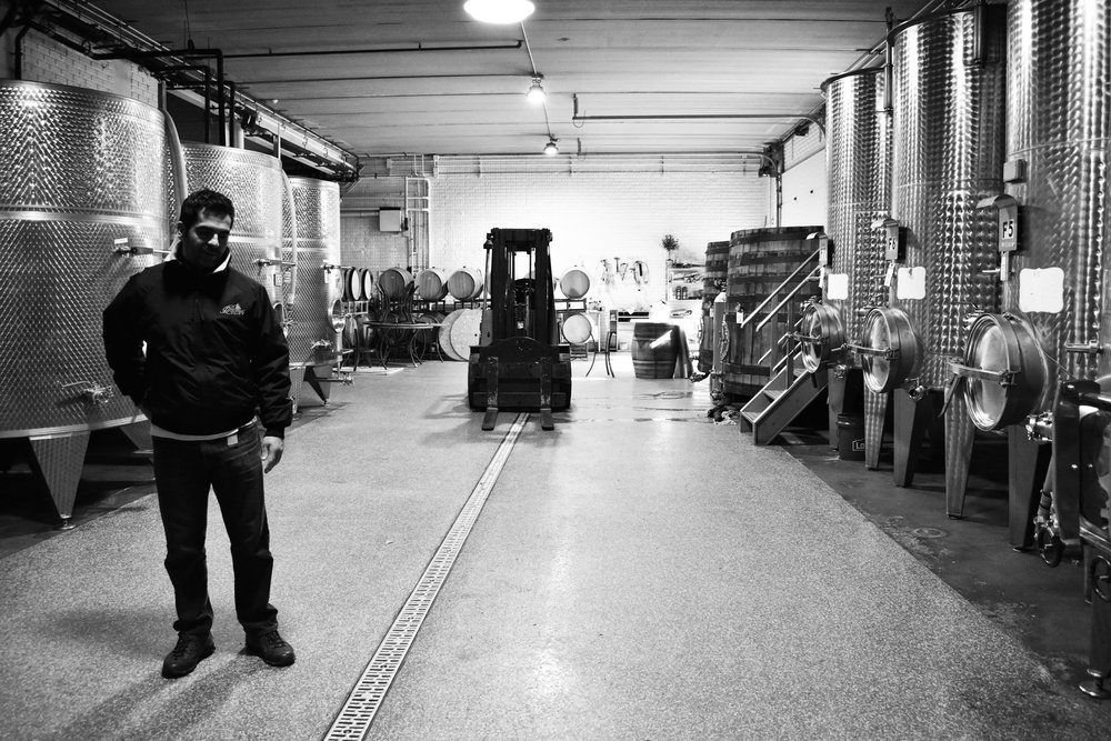 Head winemaker David Pagan Castaño surveys vats at Potomac Point Vineyard and Winery in Stafford, Va., Friday, Feb. 2, 2018. (Lindsey Leake/American University)