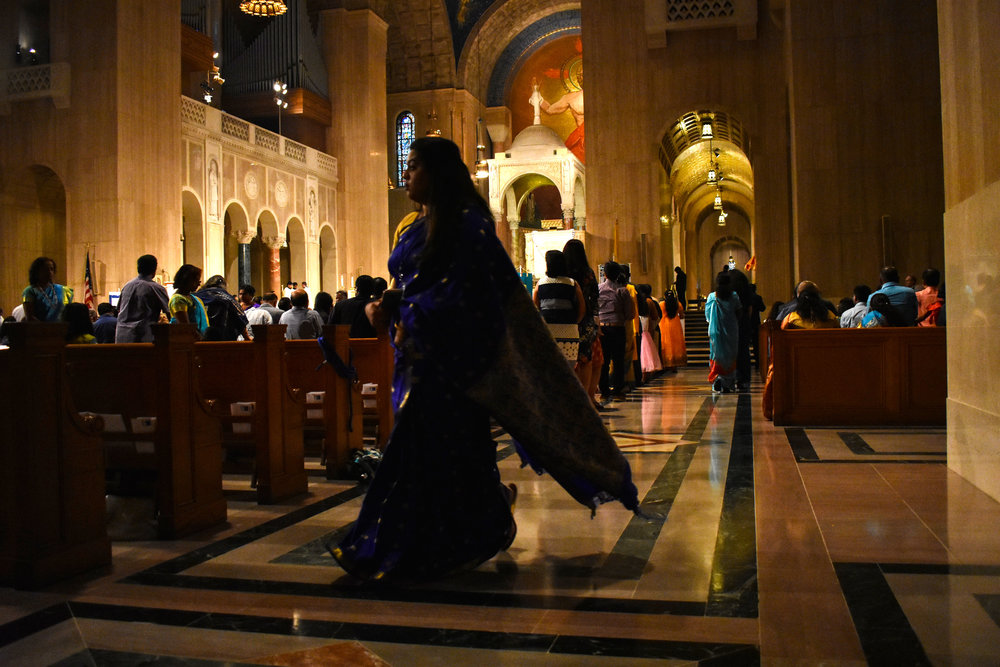Jefreena Packianathan, vice president of the Indian American Catholic Association, walks across an aisle of the Upper Church at the Basilica of the National Shrine of the Immaculate Conception in Washington, Saturday, Sept. 8, 2018. Hundreds of Catholics of South Asian descent convened for IACA's 21st Annual Pilgrimage to Our Lady of Good Health, Vailankanni. (Lindsey Leake/American University)