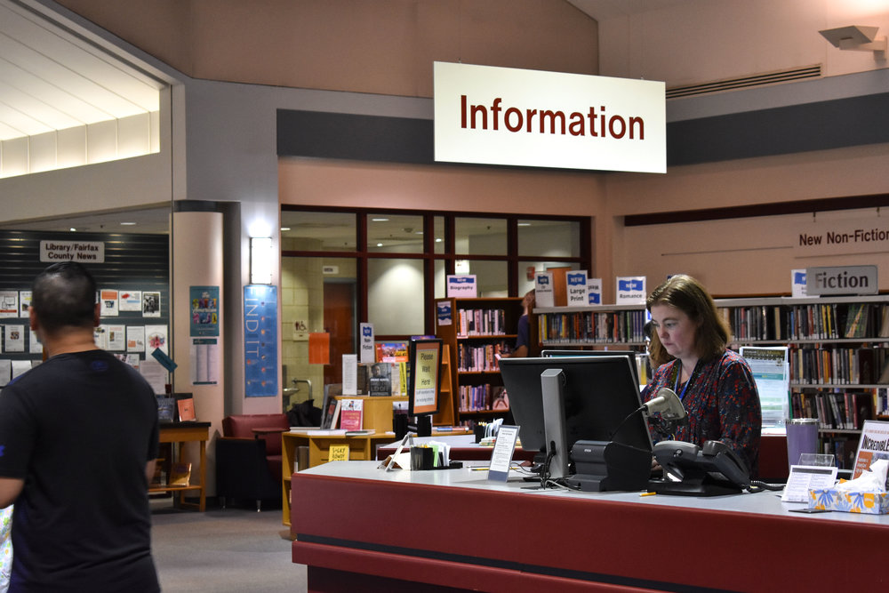 Youth services librarian Letitia Van Campen works the evening shift at George Mason Regional Library in Annandale, Va., Wednesday, Sept. 26, 2018. (Lindsey Leake/American University)
