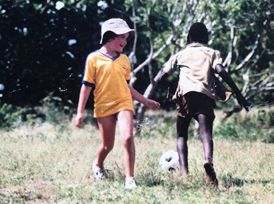 Farley playing soccer in Kenya