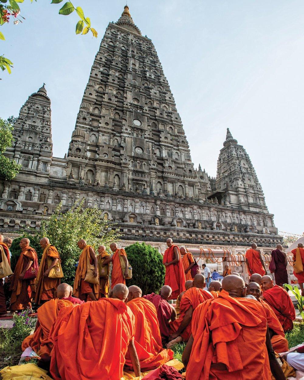 Buddhist monks amass beside Bodh Gaya's Mahabodhi Temple, a UNESCO World Heritage site. Photo by PRABUDDHARAY/GETTY IMAGES