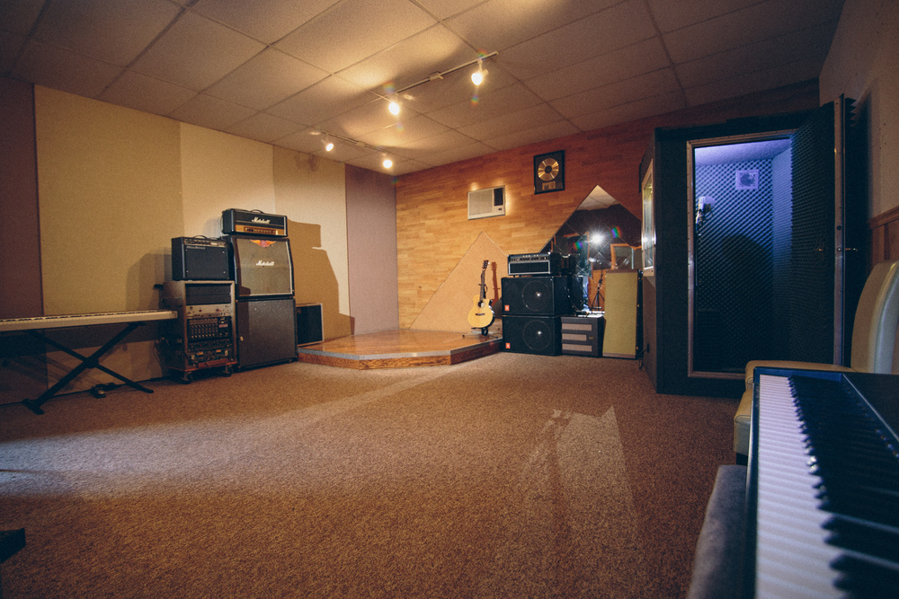 Our Live Room features plenty of room for a full band, a hardwood drum platform, spacious vocal booth, Korg Triton Keyboard, and a full backline including gear from Marshall, Mesa Boogie, Ampeg, Fender, and Vox,  For your comfort, we have plenty of seating, cold drinks, and a clean restroom.