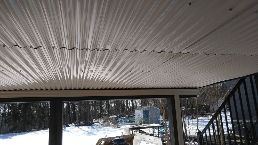 Underside of deck finished with white corrugated panels