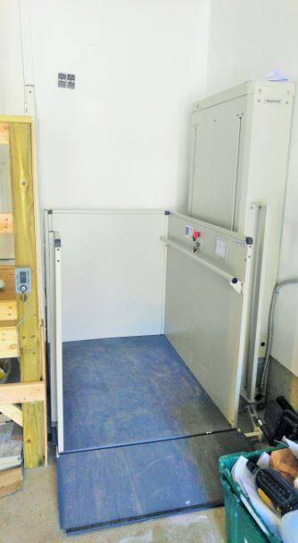 New ADA vertical platform lift (VPL) added in garage to allow for easy wheelchair accessibility to garage and vehicles. VA Project - uxbridge ma