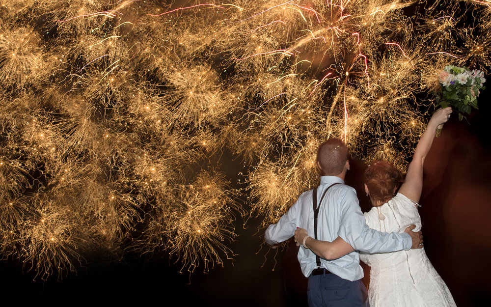 Bride and Groom with Fireworks photo