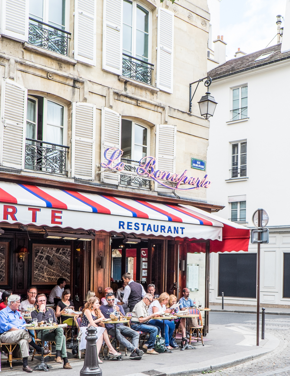 LA BONAPARTE  42 Rue Bonaparte, 75006   INSIDER TIP  | No competition: Paris does al fresco dining better than any other city! Kick up your feet for drinks at this Saint-Germain spot, known for its tri-color awning and prime people-watching opportunities.