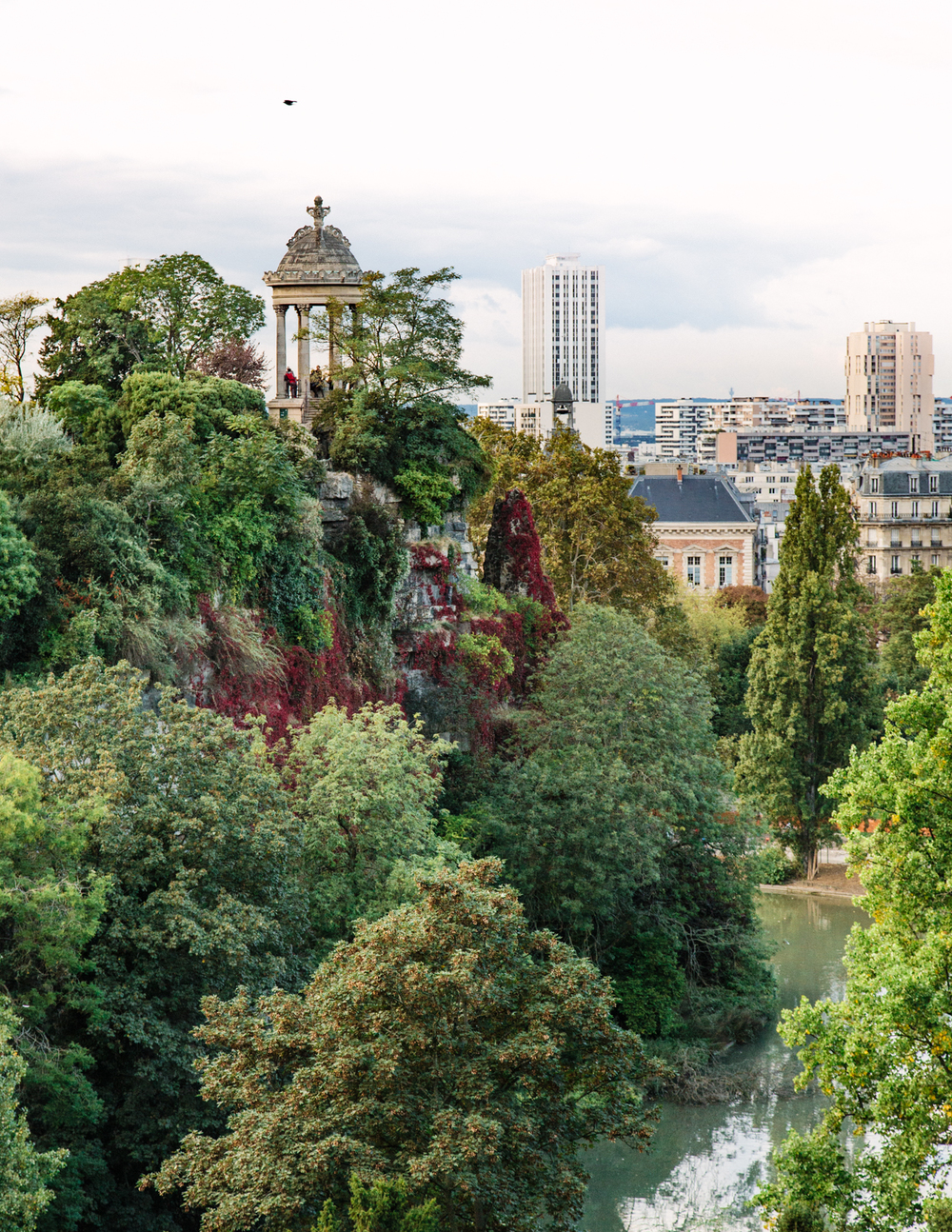 LES BUTTES CHAUMONT    INSIDER TIP  | A green happy place in Paris that's off the beaten tourist path. Head to higher vantage points for this view (or, if you're sporty, run to the top).