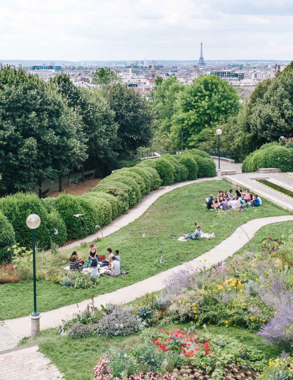 PARC DE BELLEVILLE     INSIDER TIP  | A favorite local hangout for lounging, picnicking and taking in the summer sun with a view of the entire city.    PHOTO TIP  |  Head to the highest point of the park for a view of the Eiffel Tower in your shot.