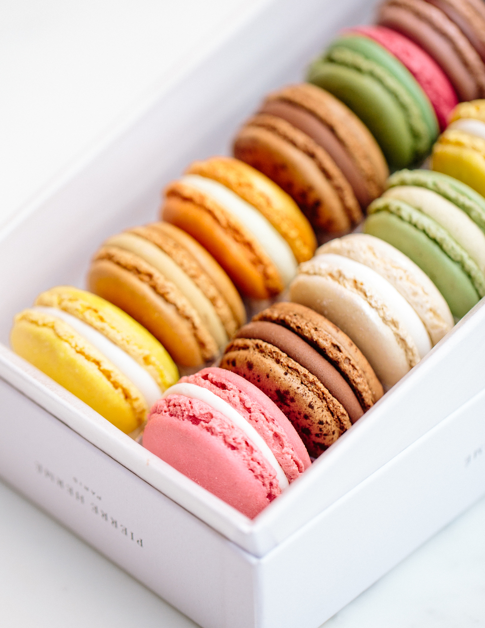 PIERRE HERMÉ various locations INSIDER TIP | Whether you stack them or line them up like jewels, Pierre Herme's macarons are otherworldy in any form. His classic flavors are among the bestsellers -- chocolate, salted caramel, vanilla, etc. - but he is known for incorporating exotic flavors, even those of the savory variety, into his limited edition collections. Be adventurous and try them all!