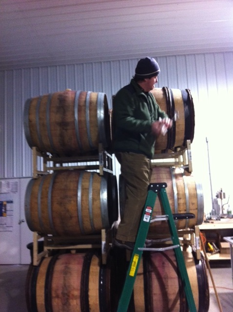"This picture is of me ""thieving"" Pinot.  What is ""thieving?""  It is the device you use to take wine out of a barrel, usually glass or plastic and kind of looks like a turkey baster."
