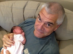 William P. Bahlke hoiding his first grandchild, Kimber Rose.