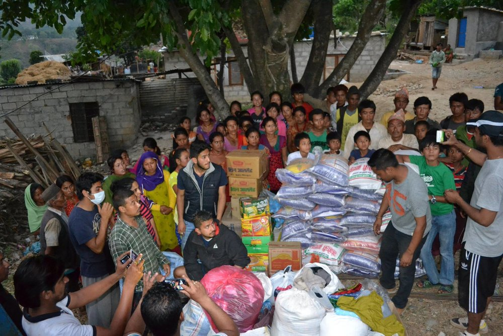Distribution of relief material in a village in Dhading distric.