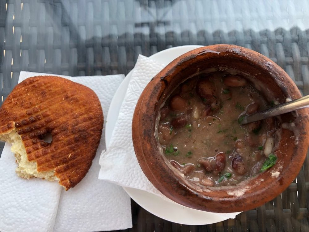 Mchadi (fried bread) and lobio (some hot beans in a pot)