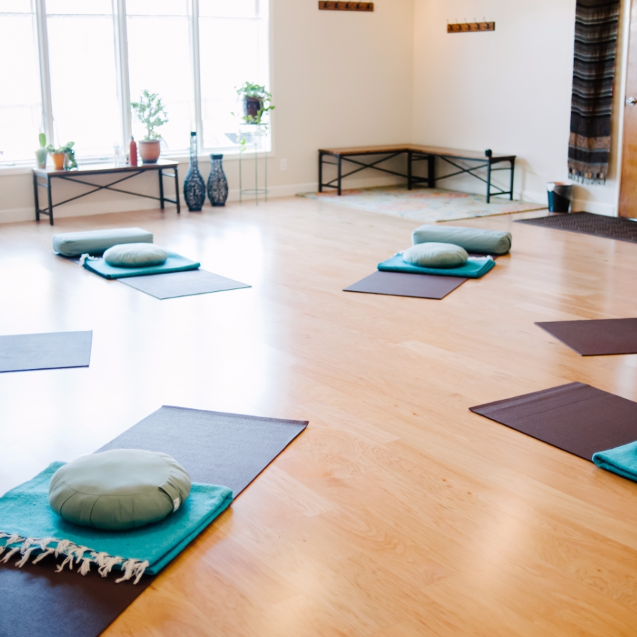 Prenatal yoga classes paired with an educational discussion forum.