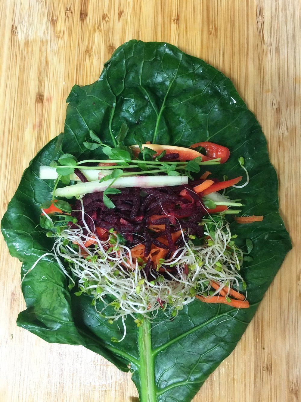 Fold the stem over veggie pile, tuck in the sides, roll tightly, repeat!