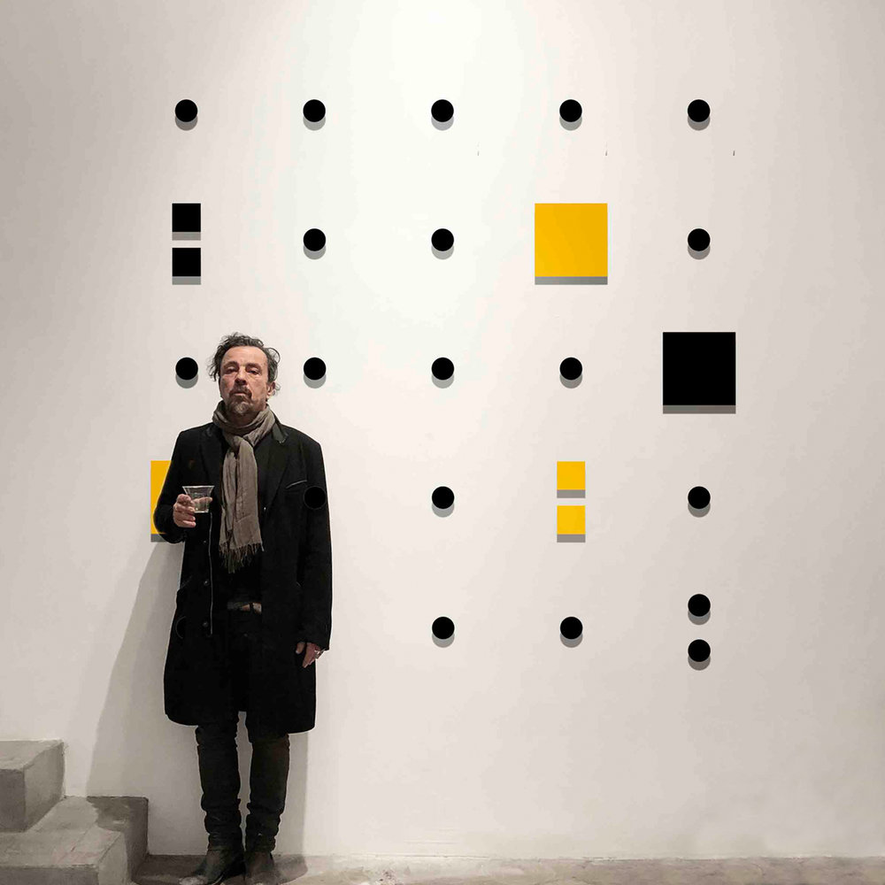 "Perici posing in front of ""Piss Off"" from ""The Word"" series"